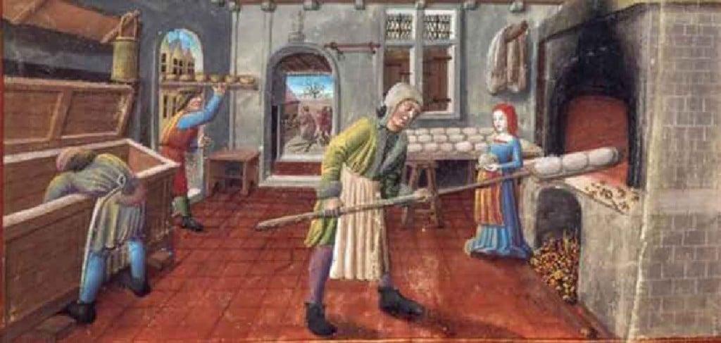 Boulangers à la fabrication du pain. Missel franciscain, 1450-1500. Bibliothèque Municipale de Lyon
